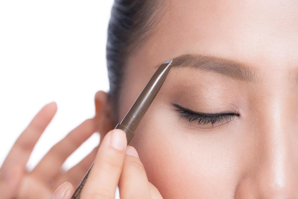 woman microblading eyebrows
