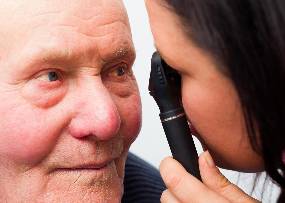 Eye Doctor seeing elderly patient for a cataract consultation