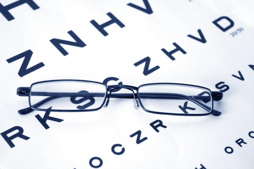 frames sitting on eye chart in Arlington optometrist office