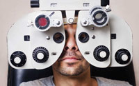 Man looking thru a Vision Machine - Eyeglasses Pensacola - Fifty Dollar Eye Guy 5328 N Davis Hwy, Pensacola FL 32503 (850) 434-6387